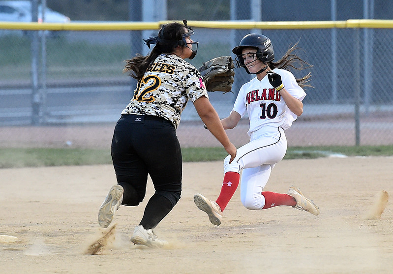 Loveland High's (10) Jessi Case slides into second as Thompson Valley's (12) Cassie Orozco waits for the ball Tuesday, Sept. 12, 2017,  during their game at Centennial Park in Loveland.  (Photo by Jenny Sparks/Loveland Reporter-Herald)
