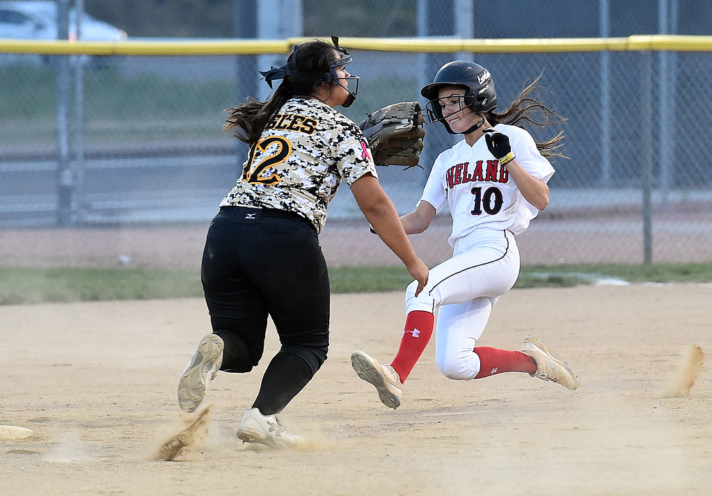 . Loveland High\'s (10) Jessi Case slides into second as Thompson Valley\'s (12) Cassie Orozco waits for the ball Tuesday, Sept. 12, 2017,  during their game at Centennial Park in Loveland.  (Photo by Jenny Sparks/Loveland Reporter-Herald)