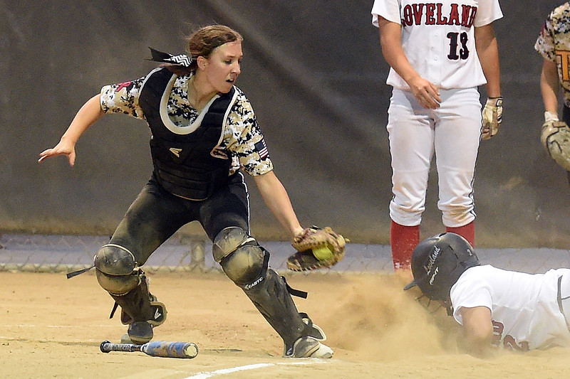 Thompson Valley's (14) catcher Autumn Porter tries to tag out Loveland High's (2) Elana Gerhard slides into home Tuesday, Sept. 12, 2017,  during their game at Centennial Park in Loveland.  (Photo by Jenny Sparks/Loveland Reporter-Herald) l2 t14