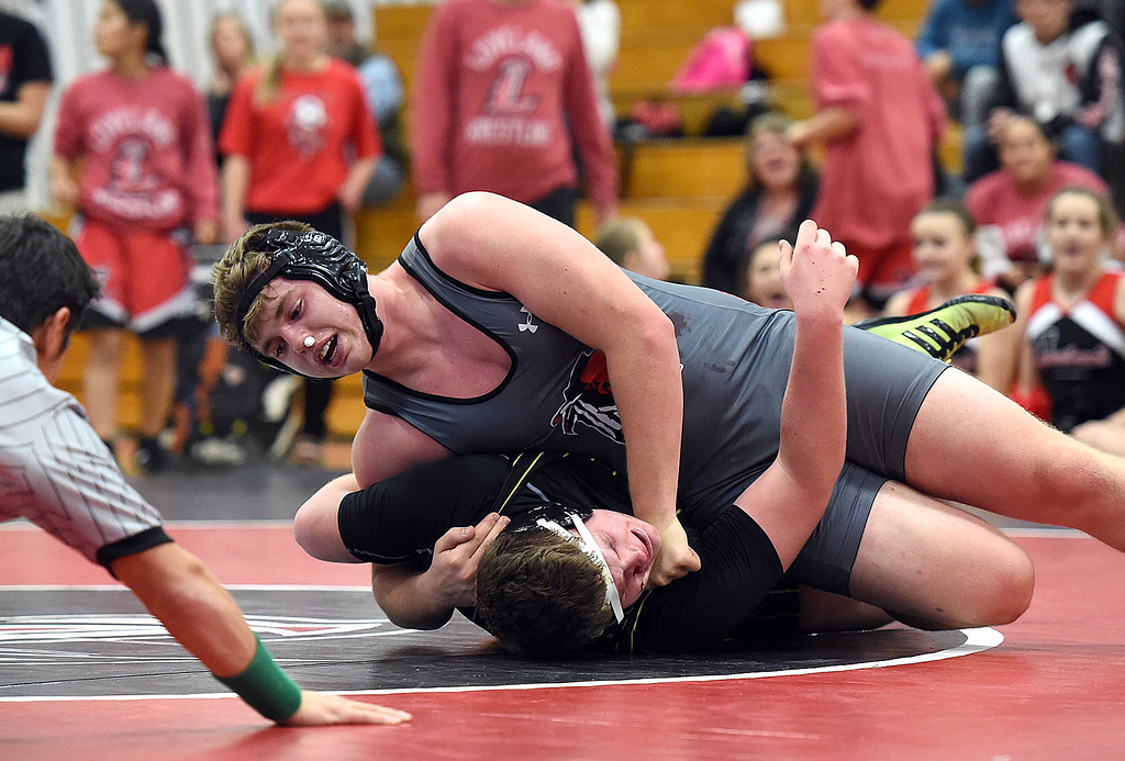 . Loveland\'s Travis Bretches wrestles Thompson Valley\'s Sage Gavin during their 285-pound match Tuesday, Jan. 9, 2018, at Loveland High School in Loveland. Nolin won the match (Photo by Jenny Sparks/Loveland Reporter-Herald)