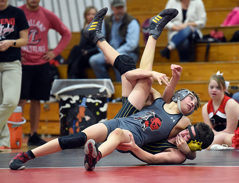 Loveland's Cody Thompson wrestles Thompson Valley's Kameron Hanel during their 106-pound match Tuesday, Jan. 9, 2018, at Loveland High School in Loveland. Thompson won the match (Photo by Jenny Sparks/Loveland Reporter-Herald)