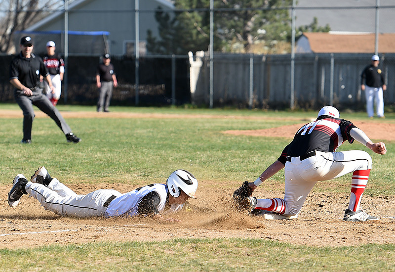 Thompson Valley's #24 Adrian Nava slides into third base as  Loveland's #11 Chris Vaccarella tries to tag him out during their game Wednesday, April 5, 2017, at Thompson Valley high School in Loveland. (Photo by Jenny Sparks/Loveland Reporter-Herald)<br /> L11 t24