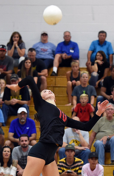 Loveland High's (10) Maddie Kinney spikes the ball during their game against Thompson Valley Thursday, Aug. 23, 2018, at Loveland High.  (Photo by Jenny Sparks/Loveland Reporter-Herald)