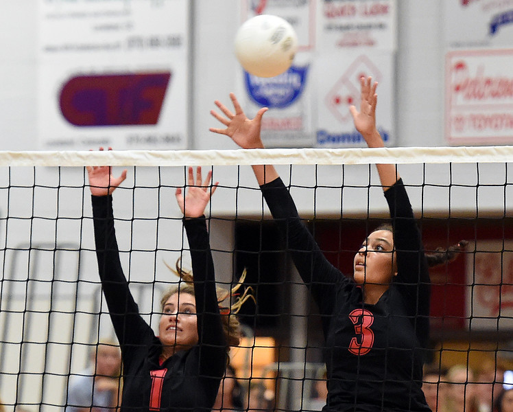Loveland High's (1) Raquel Roybal, left, and (3) Lacy Hunt try to block the ball during their game against Thompson Valley Thursday, Aug. 23, 2018, at Loveland High.  (Photo by Jenny Sparks/Loveland Reporter-Herald)