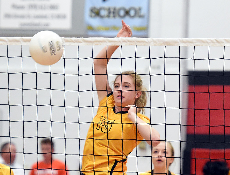 Thompson Valley's (15) Sydnee Durtsche tips the ball over the net during their game against Loveland Thursday, Aug. 23, 2018, at Loveland High.  (Photo by Jenny Sparks/Loveland Reporter-Herald)