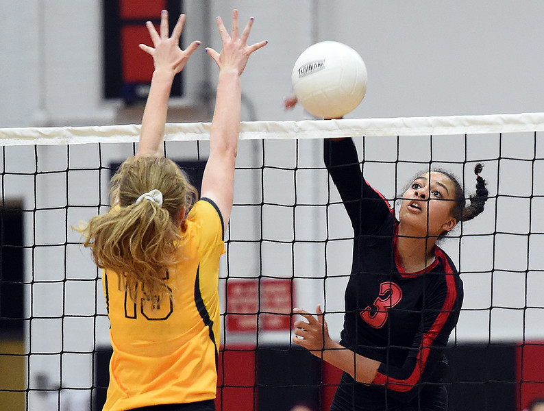 Loveland High's (3) Lacy Hunt spikes the ball during their game against Thompson Valley Thursday, Aug. 23, 2018, at Loveland High.  (Photo by Jenny Sparks/Loveland Reporter-Herald)
