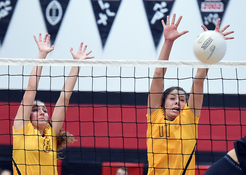Thompson Valley's (8) Kate Gentrup and (11) Jamie Sharp try to block the ball during their game against Loveland Thursday, Aug. 23, 2018, at Loveland High.  (Photo by Jenny Sparks/Loveland Reporter-Herald)