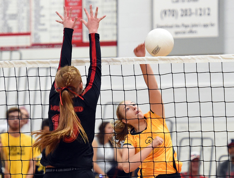 Thompson Valley's (3) Sydney Laws tips the ball over the net during their game against Loveland Thursday, Aug. 23, 2018, at Loveland High.  (Photo by Jenny Sparks/Loveland Reporter-Herald)