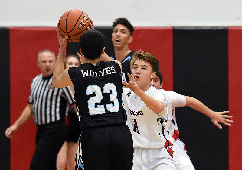 Loveland High's #11 Jaxon Cabrera tries to block Vista Ridge's #23 Julius Dowell during their game Tuesday, Dec. 12, 2017, at Loveland High School. (Photo by Jenny Sparks/Loveland Reporter-Herald)
