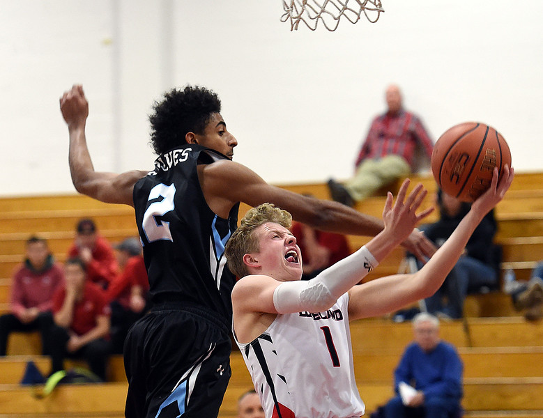 Loveland High's #1 Cody Rakowsky goes up for a shot as Vista Ridge's #2 Tola Ros tries to block during their game Tuesday, Dec. 12, 2017, at Loveland High School. (Photo by Jenny Sparks/Loveland Reporter-Herald)