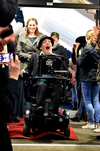 "Nick Roussos of Loveland enters the building on a red carpet surrounded by ""paparazzi"" cameras during Night to Shine at Foundations Church in Loveland. Many communities in Northern Colorado host this event every year. Photo by Thieng Mai/Loveland Reporter-Herald."