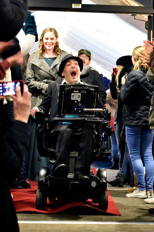 ". Nick Roussos of Loveland enters the building on a red carpet surrounded by ""paparazzi\"" cameras during Night to Shine at Foundations Church in Loveland. Many communities in Northern Colorado host this event every year. Photo by Thieng Mai/Loveland Reporter-Herald."