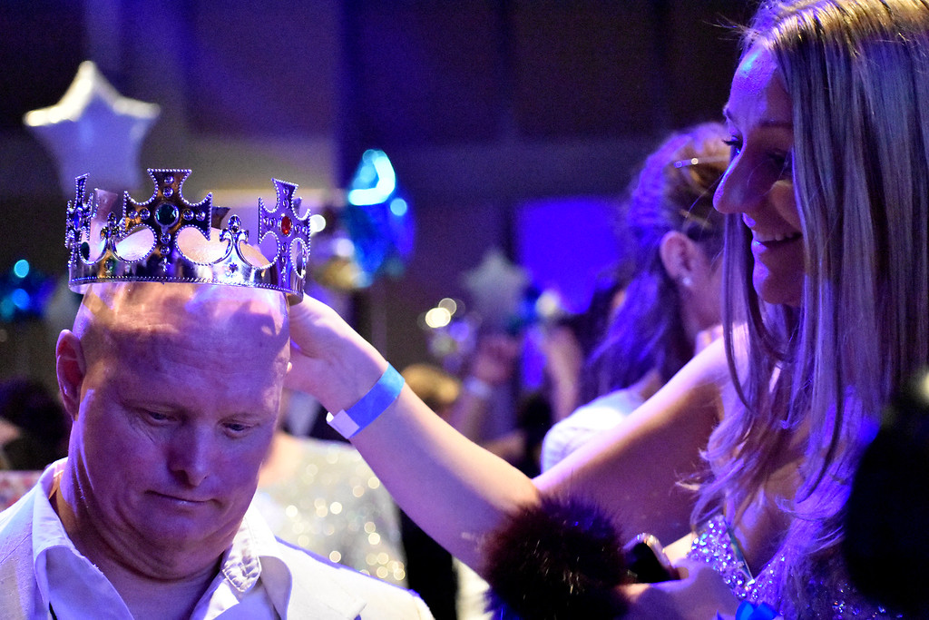 ". ""Uncle\"" Douthit (Fort Collins) is crowned by his companion, Melissa Allens (Fort Collins) during Night to Shine on Feb. 9, 2018 at Foundations Church in Loveland. Night to Shine is held every year for communities across Northern Colorado. Photo by Thieng Mai/Loveland Reporter-Herald."