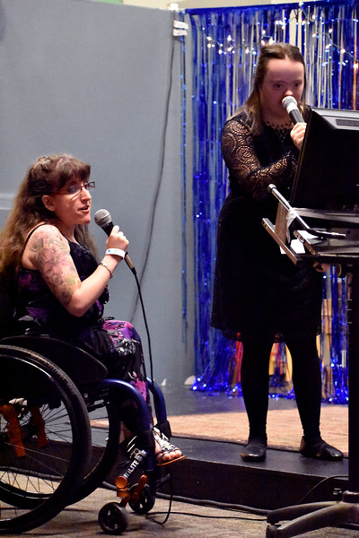 Ashley Armstrong of Loveland (left) sings along with Ashley Brooks of Loveland (right) in a karaoke session during Night to Shine at Foundations Church in Loveland. Night to Shine has many different activities for guests to enjoy aside from dancing. Photo by Thieng Mai/Loveland Reporter-Herald.