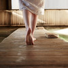 Woman walking on floorboard at Japanese spa and hot springs in California
