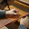 Close up of the weaving process in an artisanal workshop