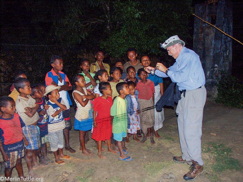 Merlin Tuttle showing bats to children in Madagascar. Conservation