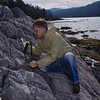 Merlin Tuttle on British Columbia's Hot Springs Island using a digital thermometer to record temperatures in a geothermally heated rock crest where Keen's myotis (Myotis keenii) bats roost.