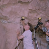 Merlin Tuttle and assistant, Bert Grantges, photographing western pipistrelles in a cliff face  crevicew in Utah. Photographing Bats