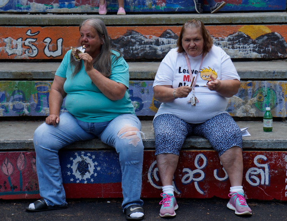 . Sena Platty, and Patricia Gardner, of Lowell, Ma. eat popsicles during Lowell�s Acre Fest Saturday, June 10th, 2017 in Lowell, Ma. The two have lived in Lowell their entire lives.   LOWELL SUN/KATIE DURKIN