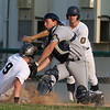 Lowell American Legion Post 8 played Newton Post 440. Lowell won 10 to 8. Newton's Christian Quigley gets the throw and tries to tag out Lowell's Keith Lynch but looses the ball on the tag. SUN/JOHN LOVE