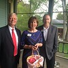 From left, John Pearson with board members Bethanne Welch and Jim Dyment, all of Lowell