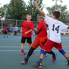 Maddox Dobson of the Gators, in red, tries to go around Mason Veits of the Celtics during the 7 to 9 year old Junior A League game at Father Maguire Park during the St. Jeanne Darc Summer basketball league. SUN/JOHN LOVE