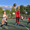 Jonathan Sullivan of the Gators goes up for the shot while Jude Silva of the Celtics tried to stop him during the 7 to 9 year old Junior A League game at Father Maguire Park during the St. Jeanne Darc Summer basketball league. SUN/JOHN LOVE