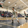 Lowell Catholic High School boys basketball player Kai Yang covers Austin Preparatory School player Logan Bravo as he tries to inbound the ball during their game on Friday night. SUN/JOHN LOVE