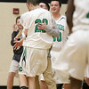 Lowell Catholic High School boys basketball player Alex Ferriere gets congratulated by his coach after making a three pointer during a time out called by Austin Preparatory School on Friday night. SUN/JOHN LOVE