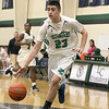 Lowell Catholic High School boys basketball player Alex Ferriere takes the ball to the hoop during their game against Austin Preparatory School on Friday night. SUN/JOHN LOVE