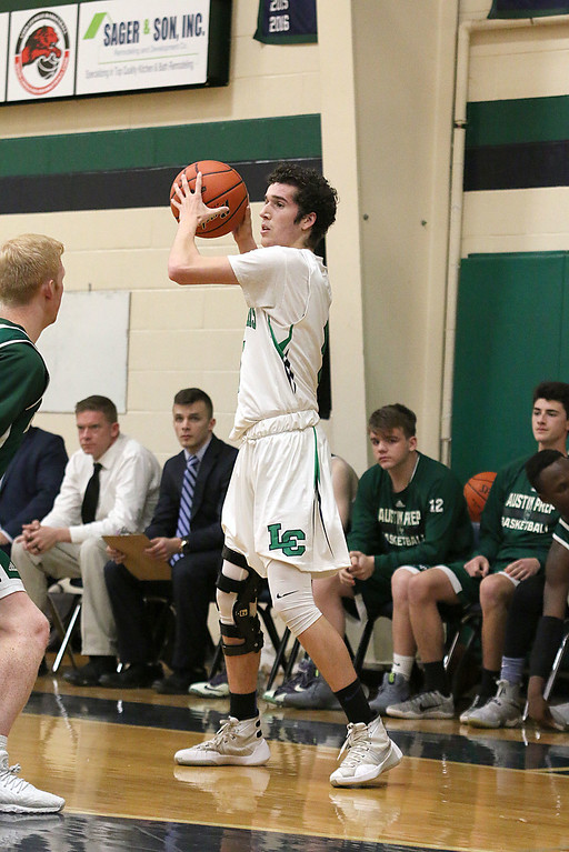 . Lowell Catholic High School boys basketball player Alex Antoine looks for a teammate to pass to during their game against Austin Preparatory School on Friday night. SUN/JOHN LOVE