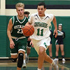 Lowell Catholic High School boys basketball player Keenan Rudy-Phol gets a break away during their game against Austin Preparatory School on Friday night. SUN/JOHN LOVE