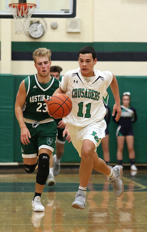 . Lowell Catholic High School boys basketball player Keenan Rudy-Phol gets a break away during their game against Austin Preparatory School on Friday night. SUN/JOHN LOVE