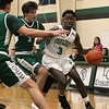 Lowell Catholic High School boys basketball player Brian Saroni tries to get around Austin Preparatory School player Denis Taylor during action in their game on Friday night. SUN/JOHN LOVE