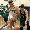Lowell Catholic High School boys basketball player Keenan Rudy-Phol and Austin Preparatory School player Aiden Beers go after a loose ball during their game on Friday night. SUN/JOHN LOVE