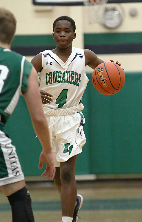 . Lowell Catholic High School boys basketball player Alex Antoine brings the ball down court during their game against Austin Preparatory School on Friday night. SUN/JOHN LOVE