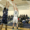 Lowell Catholic High School basketball played Pope John High School on Monday night in Lowell. LCHS player Liam Trainor puts up a shot over PJHS player Marques Bouyer. SUN/JOHN LOVE