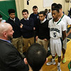 Lowell Catholic High School basketball played Pope John High School on Monday night in Lowell. LCHS Head Coach Mike Isola talks to his team during a time out. SUN/JOHN LOVE