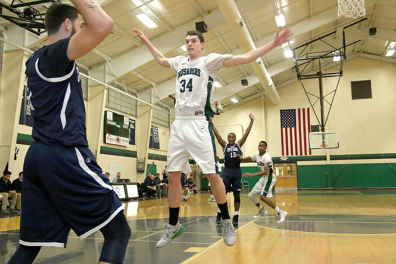 Lowell Catholic High School basketball played Pope John High School on Monday night in Lowell. LCHS player Liam Trainor guards an inbound pass from PJHS player Christian Hebert during action in the game. SUN/JOHN LOVE