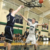 Lowell Catholic High School basketball played Pope John High School on Monday night in Lowell. LCHS player Liam Trainor guards an inbound pass from PJHS player Patrick Kelly during action in the game. SUN/JOHN LOVE