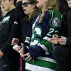 Lowell Catholic High School hockey scored two goals to beat Stoneham High School in the Division 2 North Championship at the Tsongas Center at UMass Lowell on Monday night.  Wearing her boyfriends jersey as she watches the game is LCHS student Sarah Sullivan. SUN/JOHN LOVE