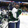 Lowell Catholic High School hockey scored two goals to beat Stoneham High School in the Division 2 North Championship at the Tsongas Center at UMass Lowell on Monday night. Michael Talbot and Nathan Donaldson celebrate their victory. SUN/JOHN LOVE
