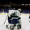 Lowell Catholic High School hockey scored two goals to beat Stoneham High School in the Division 2 North Championship at the Tsongas Center at UMass Lowell on Monday night. LCHS teammates celebrate their win. SUN/JOHN LOVE