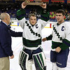 Lowell Catholic High School hockey scored two goals to beat Stoneham High School in the Division 2 North Championship at the Tsongas Center at UMass Lowell on Monday night. LCHS goalie Stephen D'Urso holds up the trophy with Head Coach Thomas Curran and teammate Cam Pereira. SUN/JOHN LOVE
