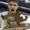 Lowell Catholic High School hockey scored two goals to beat Stoneham High School in the Division 2 North Championship at the Tsongas Center at UMass Lowell on Monday night. Cam Pereira celebrates their victory with the trophy. SUN/JOHN LOVE