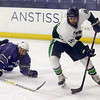 Lowell Catholic High School hockey scored two goals to beat Stoneham High School in the Division 2 North Championship at the Tsongas Center at UMass Lowell on Monday night. LCHS player Alex Graves takes control of the puck during action in the game. SUN/JOHN LOVE