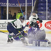 Lowell Catholic High School hockey scored two goals to beat Stoneham High School in the Division 2 North Championship at the Tsongas Center at UMass Lowell on Monday night. LCHS player Mitchell Andrea tries to get the puck away from SHS goalie Anthony Orlando during action in the game. Looking on is LCHS player Connor Doherty.SUN/JOHN LOVE