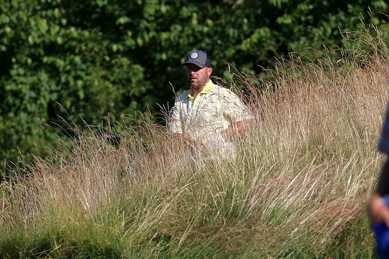 Mike Walker hist out of some tall grass on to the green during the Lowell City Golf Tournament at Vesper Country Club in Tyngsboro on Wednesday afternoon. SUN/JOHN LOVE