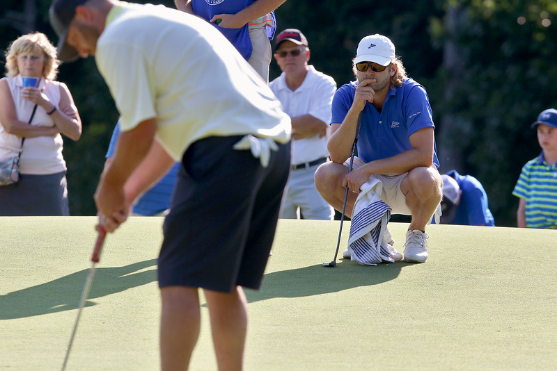 Winner of the Lowell City Golf Tournament at Vesper Country Club in Tyngsboro Rich Campiola thinks about his shot as second place winner Mike Walker makes a putt during the tournament. SUN/JOHN LOVE